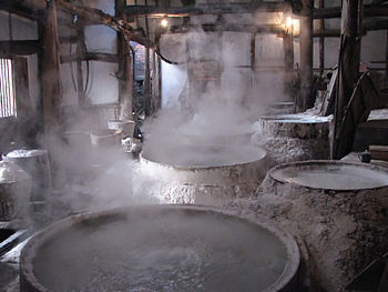 Brine being boiled down to produce salt at the...