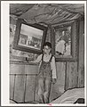 Indian boy between portraits of his ancestors. Near Sallisaw, Oklahoma.jpg