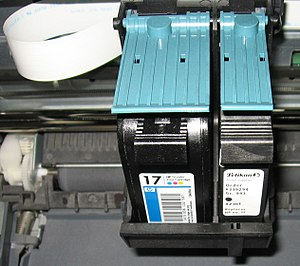 Two cartridges (one with black ink, one with colored inks) installed in an inkjet printer.