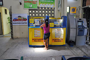 Microcredit - Many microfinance institutions also offer savings facilities, such as Banco Palma in Brazil shown here.