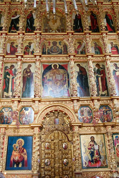 Mid-17th-century iconostasis at Ipatiev Monastery. To either side of the Holy Doors are Christ Pantokrator and the Theotokos; above them, the Great Feasts; above them, the Deesis; above that Prophets to either side of Our Lady of the Sign; above them the Apostles to either side of the Holy Trinity. Ipatios monastery Kostroma 13.jpg