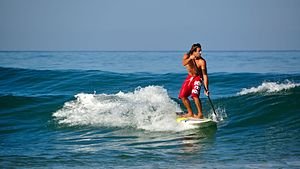 Standup paddleboarding - Standup paddleboarding in light surf.