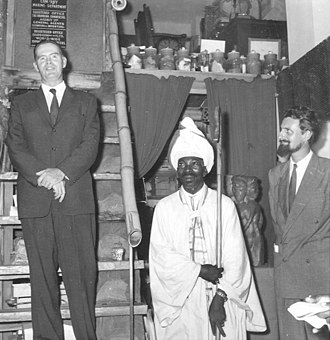 """Christopher Hills - Governor of Jamaica Sir Hugh Foot opening a 1957 Hills Galleries exhibition showing works by Mallica """"Kapo"""" Reynolds with Christopher Hills"""