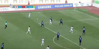 Vietnam national under-23 football team - Vietnam (white) leading by 1–0 during their group match against Japan (blue) in the 2018 Asian Games.