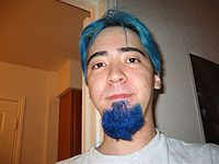 Hair and beard dyed blue.