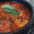 Jiggle What, Jiggae Who - Kimchi. rice cakes, pork belly (15056352413).jpg