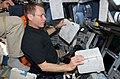 Johnson Working on the Shuttle Atlantis Flight Deck during HST Rendezvous (28098822861).jpg