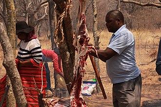 Skinning - A Kalanga man skinning a goat at the annual Domboshaba cultural festival 2017 in Botswana