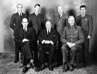 Georges Vanier - Vanier (seated, right), with William Lyon Mackenzie King (seated, centre), and other members of the Canadian delegation dispatched to the United Kingdom to discuss war planning, 1941