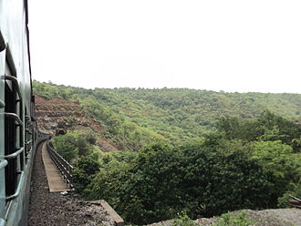 Konkan Railway - A train entering Chiplun Railway Tunnel