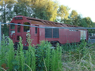London Underground electric locomotives - L11 preserved outside Epping station.