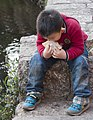 Lijiang Yunnan China-Chinese-boy-eating-local-delicassy-01.jpg