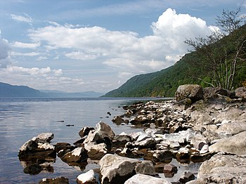 The rocky shoreline of Loch Ness, Scotland