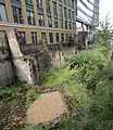 London Wall section of Roman and medieval wall and bastion at Noble Street North View.jpg