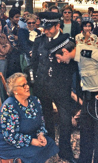 Metropolitan Police Service - Metropolitan Police officers talk to a seated woman, July 1976.