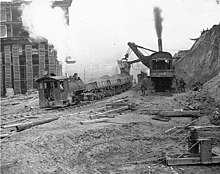 Looking Northeast on Virginia St from 4th Ave showing regrade work using a steam shovel, Seattle, Washington, October 1909 (LEE 121).jpeg