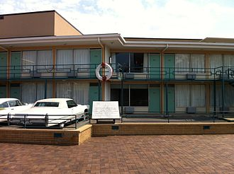 Assassination of Martin Luther King Jr. - The motel is now part of the complex of the National Civil Rights Museum. The wreath marks the approximate spot where King was shot.