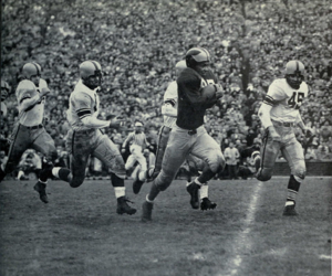 Lowell Perry - Perry (No. 85) eludes opposing players, 1951