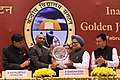 M.M. Pallam Raju presenting a memento to the Prime Minister, Dr. Manmohan Singh at the Golden Jubilee Celebrations of the Kendriya Vidyala Sangathan (KVS).jpg