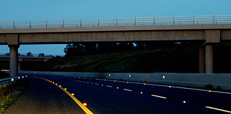 Cat's eye (road) - M9 motorway in Carlow, Ireland, with cat's eyes on the road surface and retroreflectors on barriers