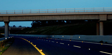 M9 motorway in Carlow, Ireland, with cat's eyes on the road surface and retroreflectors on barriers M9 motorway Carlow Ireland catseyes.jpg