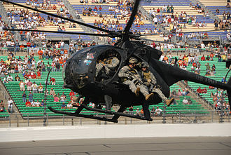 160th Special Operations Aviation Regiment (Airborne) - An MH-6 carrying Army Rangers prepares to land during an infiltration demonstration at the Kansas Speedway 400 in 2008.