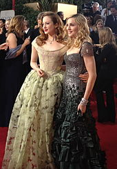 Andrea Riseborough and Madonna in gowns