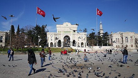 Main entrance gate of Istanbul University on Beyazit Square, which was known as Forum Tauri (later Forum of Theodosius) in the late Roman period. Beyazit Tower, located within the campus, is seen in the background, to the right of the flagpole. Main entrance gate of Istanbul University.jpg