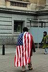 Man wrapped in US flag.jpg