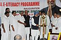 Manmohan Singh lighting the lamp to inaugurate the Total E-Literacy Project, organised by P.N. Panicker Vigyan Vikas Kendra, at Thiruvananthapuram in Kerala. The Governor of Kerala, Shri Nikhil Kumar.jpg