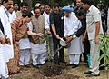 Manmohan Singh planting a sapling after the distribution ceremony of the Forest Land Pattas, Oil Engine and pvc pipes (As package) and 3 months food grains to BPL card holders, in Nandurbar, Maharashtra on September 29, 2010.jpg