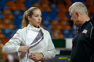 Ed Korfanty - Korfanty with Mariel Zagunis at the 2014 Orléans Grand Prix