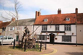"Withnail and I - ""The King Henry"" played by the Crown Inn, Stony Stratford. The great elm tree outside the pub and shown in the film subsequently died of Dutch Elm Disease and has been replaced."