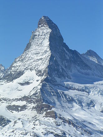 On the right side of the Matterhorn, in the shadow, is its north face Matterhorn-mostlyEastSide-viewedFromRothorn.jpg