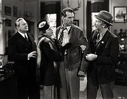 Film still of Edward Arnold, Barbara Stanwyck, Gary Cooper, and Walter Brennan
