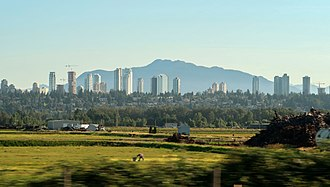 Skyline of Burnaby, British Columbia's third largest city and suburb of Vancouver Metrotown 201807.jpg