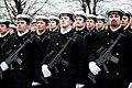Ministru prezidents Valdis Dombrovskis vēro Nacionālo bruņoto spēku vienību militāro parādi 11.novembra krastmalā (6357754977).jpg