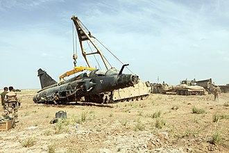 Dassault Mirage 2000N/2000D - An M88 Recovery Vehicle hoists the body of a downed French Mirage 2000D aircraft of Nancy – Ochey Air Base during a recovery mission 27 May 2011. in the Bakwa district of Regional Command West in Afghanistan.