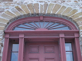 Fanlight semicircular or semi-elliptical window with bars radiating out like an open fan, above another window or a doorway