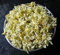 Moringa oleifera flowers ready to be cooked.jpg