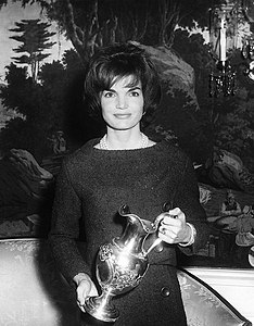 Mrs. Kennedy receives a silver pitcher for the White House. White House, Diplomatic Reception Room.jpg