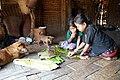 Mru children eating in a traditional home.jpg