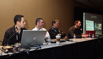 "Martin O'Donnell - O'Donnell (second from right) at a Game Developers Conference 2010 talk on ""The Musical Recipe of Emotion"""