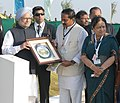N. Kiran Kumar Reddy presenting a memento to the Prime Minister, Dr. Manmohan Singh, after unveiling the CoP-11 Commemorative Pylon, at the Biodiversity Complex, in Hyderabad.jpg