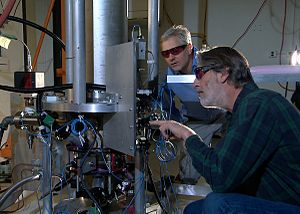 Atomic clock - NIST physicists Steve Jefferts (foreground) and Tom Heavner with the NIST-F2 caesium fountain atomic clock, a civilian time standard for the United States.