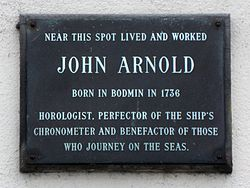 Photo of John Arnold black plaque