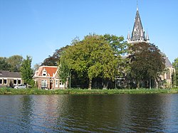 View of St. Urbanus over the river Amstel
