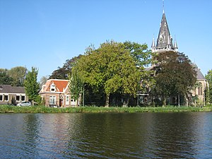 Nes aan de Amstel - View of St. Urbanus over the river Amstel