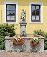 Neukirchen an der Wild - Brunnen mit Florianistatue.JPG
