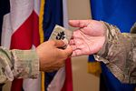 Newly frocked Senior Chief Iris Gonzales changes her rank insignia (Image 1 of 4) 160602-N-RU350-419.jpg
